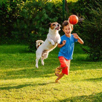 Kid-Playing-In-Yard